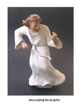 Jesus playing air guitar